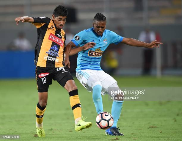 Bolivias The Strongest player Raul Castro vies for the ball with Peru's Sporting Cristal player Pedro Aquino during their Copa Libertadores match at...