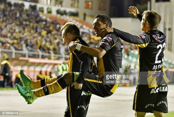 Bolivia's The Strongest player Walter Veizaga celebrates after scoring against Peru's Sporting Cristal during their Copa Libertadores match at...