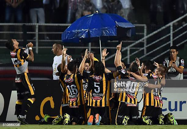 Bolivia's The Strongest players celebrate a goal scored by Matias Alonso against Brazils Sao Paulo during their 2016 Copa Libertadores football match...