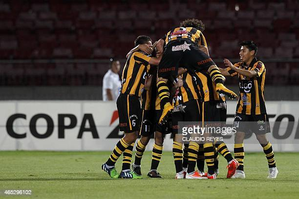 Bolivia's The Strongest's footballers celebrate Pablo Escobar's goal against Universidad de Chile during their Copa Libertadores football match at...