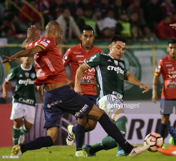 Bolivia's Wilstermann player Alex Silva vies for the ball with Raphael Veiga of Brazil's Palmeiras during their Copa Libertadores football match at...