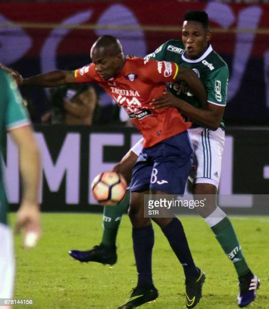 Bolivia's Wilstermann player Luis Carlos Cabezas vies for the ball with Yerry Mina of Brazil's Palmeiras during their Copa Libertadores football...