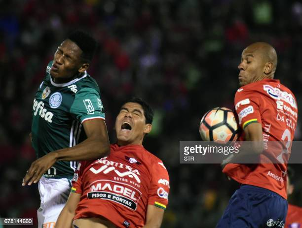Bolivia's Wilstermann players Edward Zenteno and Alex Silva vie for the ball with Yerry Mina of Brazil's Palmeiras during their Copa Libertadores...