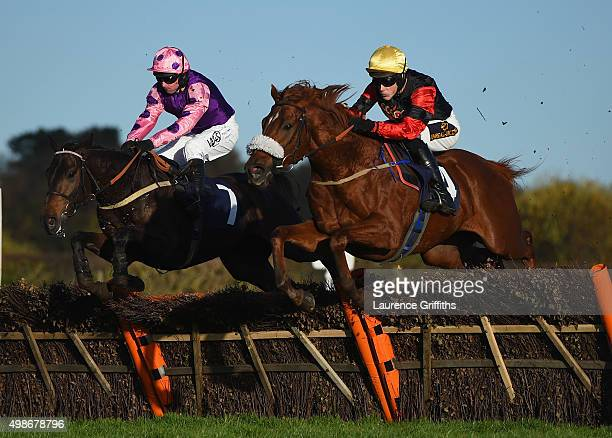 Bollihope ridden by James Davies jumps alongside Goldslinger ridden by Paul Moloney at Wetherby Racecourse on November 25 2015 in Wetherby England