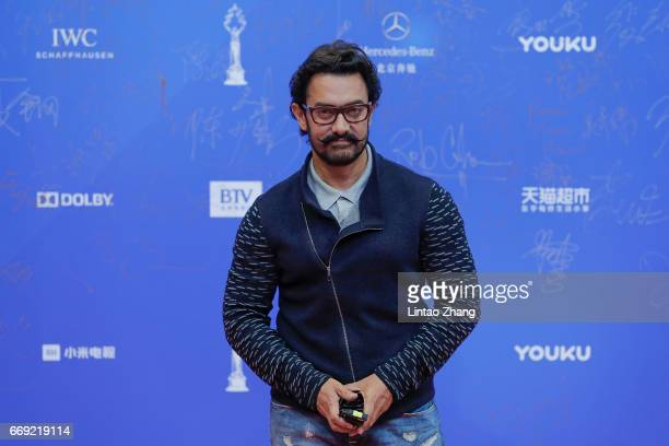 Bollywood actor Aamir Khan arrives at the red carpet of the 7th Beijing International Film Festival on April 16 2017 in Beijing China