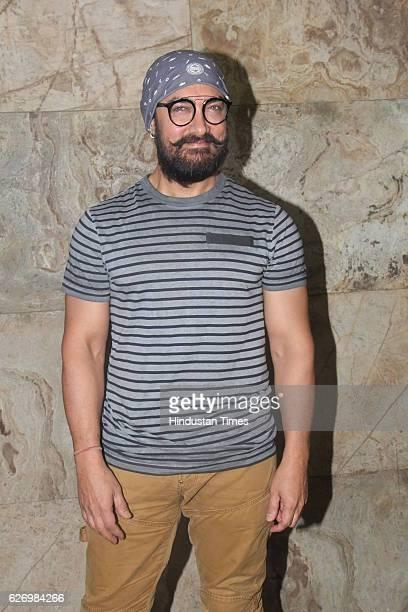 Bollywood actor Aamir Khan during screening of making of Dangal at Lightbox Santacruz on November 28 2016 in Mumbai India Dangal is a sports biopic...
