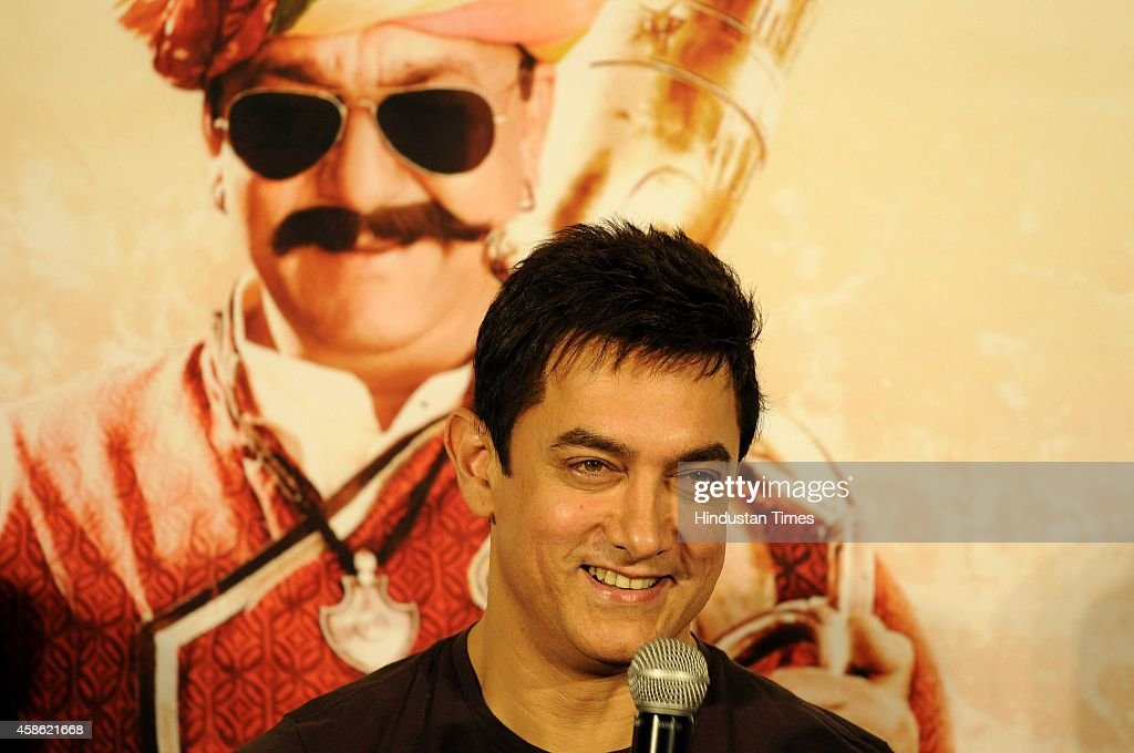 Bollywood actor <a gi-track='captionPersonalityLinkClicked' href=/galleries/search?phrase=Aamir+Khan+-+Actor&family=editorial&specificpeople=806800 ng-click='$event.stopPropagation()'>Aamir Khan</a> during the launch of song from the upcoming Bollywood movie PK, on November 8, 2014 in Noida, India. The song is a dedication from Sanjay Dutt to Aamir, where he calls Aamir 'Tharki chokra'. It has a very Rajasthani feel to it and Hirani has roped in talented Rajasthani singer Swaroop Khan to be the voice of the song. PK is an upcoming Hindi comedy-drama family film directed by Rajkumar Hirani. It stars <a gi-track='captionPersonalityLinkClicked' href=/galleries/search?phrase=Aamir+Khan+-+Actor&family=editorial&specificpeople=806800 ng-click='$event.stopPropagation()'>Aamir Khan</a> as the titular role with Sanjay Dutt, Anushka Sharma, Sushant Singh Rajput, Boman Irani and Saurabh Shukla appearing in supporting roles. Hirani has stated that the film will be a satire on 'Hindu gods and godmen'. The film has a scheduled release date of December 19.