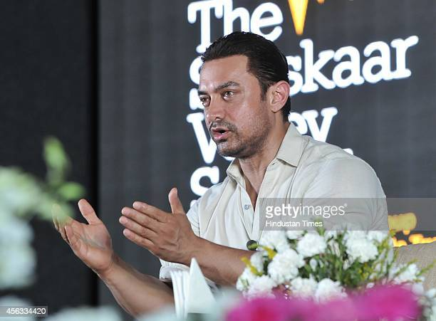 Bollywood actor Aamir Khan interacting with students during Round Square International Conference at Sanskar Valley School on September 29 2014 in...