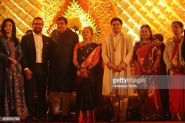 Bollywood actor Aamir Khan Union Minister Nitin Gadkari and his wife Kanchan Gadkari with newlywed daughter Ketki and soninlaw Aditya Kaskhedikar at...