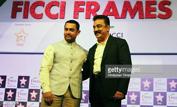 Bollywood actor Aamir Khan with actor and Chairman of FICCI MBEC South Kamal Haasan during the inaugural session of FICCI Frames 2015 held at...