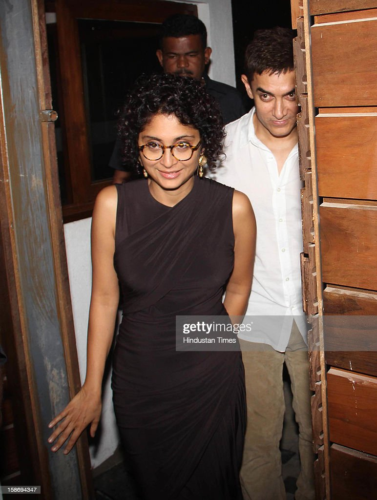 Bollywood actor Aamir Khan with his wife Kiran during Imran Khan's house warming party on December 22, 2012 in Mumbai, India.