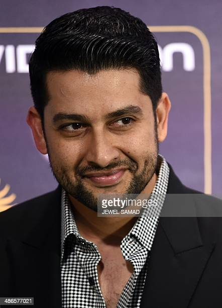 Bollywood actor Aftab Shivdasani poses on the green carpet at the Tampa Convention Center ahead of IIFA Rocks on the second day of the 15th...