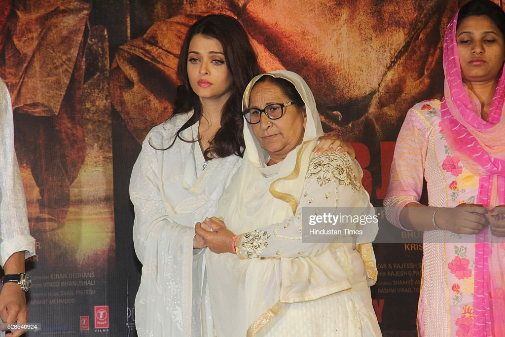 Bollywood actor Aishwarya Rai Bachchan with Sarabjit Singh's sister Dalbir Kaur and daughter Poonam Kaur during the 3rd death anniversary of Sarabjit Singh - a farmer from Punjab who was convicted of terrorism and spying by a Pakistani court, at ISKCON, Juhu, on May 4, 2016 in Mumbai, India. The function started with the recitation of some hymns from the Guru Granth Sahib, followed by the introduction of Sarabjit's family by the film's cast. The film will be narrated through the perspective of Sarabjit Singh's sister Dalbir Kaur played by Aishwarya Rai. The movie is schedule to release on May 20, 2016.