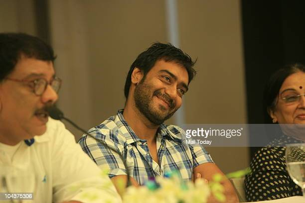 Bollywood actor Ajay Devgan director Priyadarshan along with slain Nitish Katara's mother Neelam Katara during a promotional event of their upcoming...