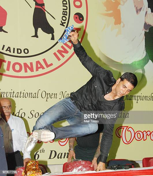 Bollywood actor Akshay Kumar jumps over the dais at the 1st Invitational Open Karate Championship held in Mumbai on Wednesday October 21 2009
