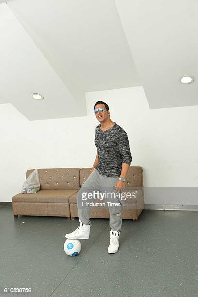 Bollywood actor Akshay Kumar poses with football during the grand opening ceremony of HT GIFA2016 at Thyagaraj Stadium on September 24 2016 in New...