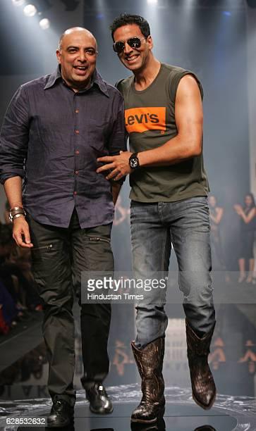Bollywood Actor Akshay Kumar with Models walks on the ramp in a Tarun Tahiliani creation at Lakme Fashion Week at Grand Hyatt