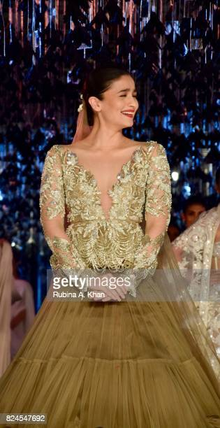 Bollywood actor Alia Bhatt walks for Manish Malhotra at the FDCI's India Couture Week 2017 at the Taj Palace hotel on July 30 2017 in New Delhi India