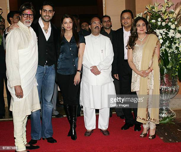 Bollywood actor Amitabh Bachchan his actor son Abhishek Bachchan and his wife Aishwarya Rai along with Indian politician Amar Singh attend a party...