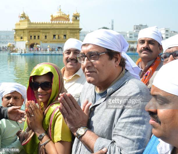 Bollywood actor and and BJP Lok Sabha Candidate from Gurdaspur Vinod Khanna along with his wife Kavita Khanna at Golden Temple on March 26 2014 in...