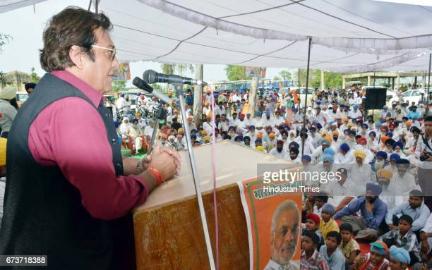 Bollywood actor and and BJP Lok Sabha Candidate from Gurdaspur Vinod Khanna during an election campaign at Saroopwali Village at Gurdaspur on April...