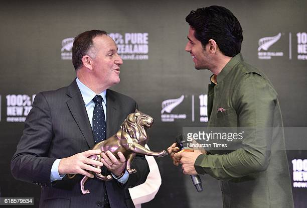 Bollywood actor and Brand Ambassador of New Zealand Tourism Sidharth Malhotra with New Zealand Prime Minister John Key during an event to promote New...