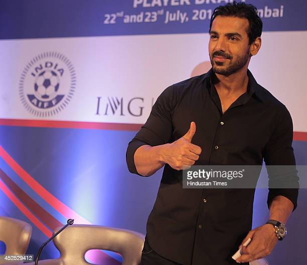 Bollywood actor and coowner of North East United FC John Abraham during the player draft of Hero Indian Super league on July 22 2014 in Mumbai India...
