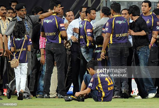 Bollywood actor and Indian Premier League franchise Kolkata Knight Riders coowner Shah Rukh Khan interacts with officials as his daughter Suhana...