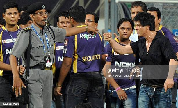 Bollywood actor and Indian Premier League franchise Kolkata Knight Riders coowner Shah Rukh Khan gestures towards a security guard blowing a whistle...
