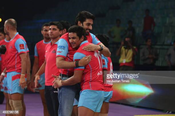 Bollywood actor and Jaipur team owner Abhishek Bachchan cheers his team players during ProKabaddi league match between Jaipur Pink Panthers and...