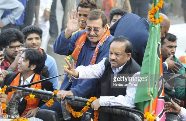 Bollywood actor and Member of Parliament Vinod Khanna with BJP CM Candidate Harshvardan during a road show in Krishna Nagar for Delhi Assembly...