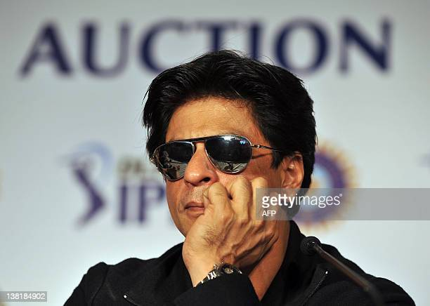 Bollywood actor and owner of Kolkatta Knight Riders Shah Rukh Khan listens to questions during a a postplayers' auction press conference for the...