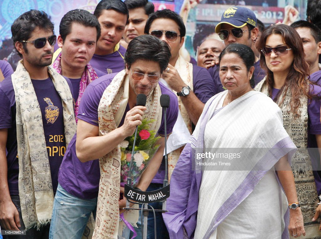Bollywood actor and owner Shahrukh Khan speaks beside Chief Minister Mamta Banerjee after the Kolkata Knight Riders won 5th edition of Indian Premier Leauge, at Writers Building on May 29, 2012 in Kolkata, India. State Government and Bengal Cricket Association jointly felicitated the team.