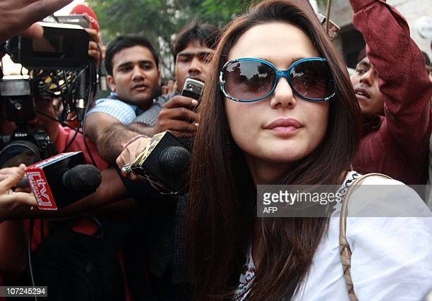 Bollywood actor and partowner of the axed Indian Premier League team Kings XI Punjab Preity Zinta is sorrounded by media representatives as she...