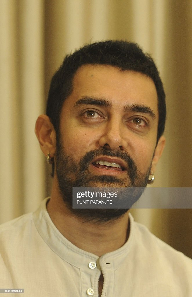 Bollywood actor and producer <a gi-track='captionPersonalityLinkClicked' href=/galleries/search?phrase=Aamir+Khan+-+Actor&family=editorial&specificpeople=806800 ng-click='$event.stopPropagation()'>Aamir Khan</a> smiles as he speaks during the news conference to promote his new film 'Dhobi Ghat', in Mumbai on January 20, 2011. Dhobi Ghat is a Hindi language film directed by Kiran Rao and its scheduled for release in cinemas on January 21. AFP PHOTO/ Punit PARANJPE