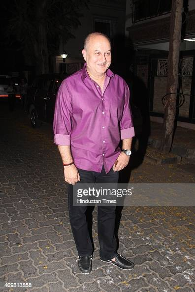 Bollywood actor Anupam Kher arrives for actor Anil Kapoors gettogether to share the trailer of the film Dil Dhadakne Do on April 13 2015 in Mumbai...