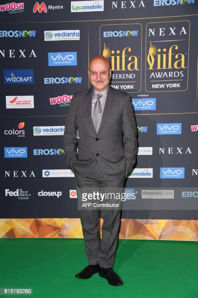 Bollywood Actor Anupam Kher arrives for the IIFA Awards July 15 2017 at the MetLife Stadium in East Rutherford New Jersey during the 18th...