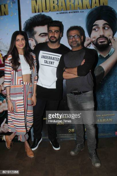 Bollywood actor Arjun Kapoor celebrates his birthday with Athiya Shetty and filmmaker Anees Bazmee on June 25 2017 in Mumbai India