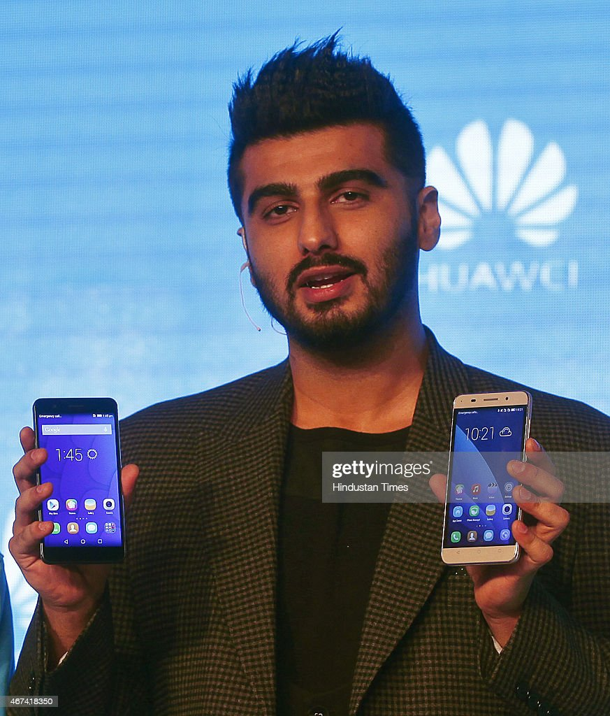 Bollywood actor <a gi-track='captionPersonalityLinkClicked' href=/galleries/search?phrase=Arjun+Kapoor&family=editorial&specificpeople=6147223 ng-click='$event.stopPropagation()'>Arjun Kapoor</a> poses with Honor 6 Plus and Honor 4X Smartphones during the launch on March 24, 2015 in New Delhi, India. Chinese handset maker Huawei said it aims to sell two million units of its Honor range of handsets in India this year as it aims to target the digital natives in the country with the online-only brand.