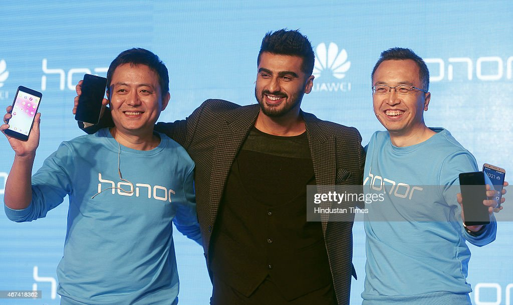 Bollywood actor Arjun Kapoor with Honor Mobiles president George Zhao and Honor Mobiles president consumer business Allen Wang during the launch new...