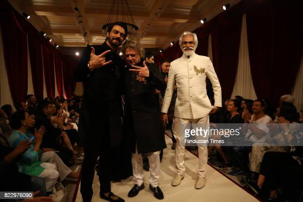 Bollywood actor Arjun Rampal with designer Rohit Bal and FDCI President Sunil Sethi showcasing the couture collection of designer Rohit Bal during...