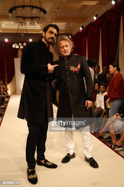 Bollywood actor Arjun Rampal with designer Rohit Bal showcasing the couture collection of designer Rohit Bal during the first day of India Couture...