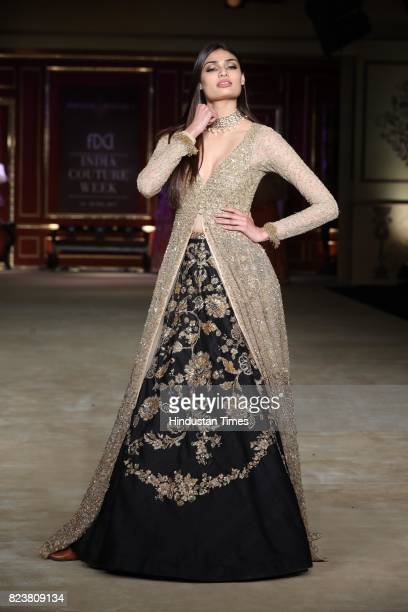 Bollywood actor Athiya Shetty walks on the ramp showcasing the creation by designers Shyamal Bhumika during the third day of India Couture Week 2017...