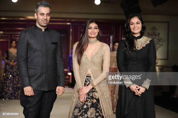Bollywood actor Athiya Shetty walks on the ramp with designers Shyamal Bhumika during the third day of India Couture Week 2017 organised by Fashion...