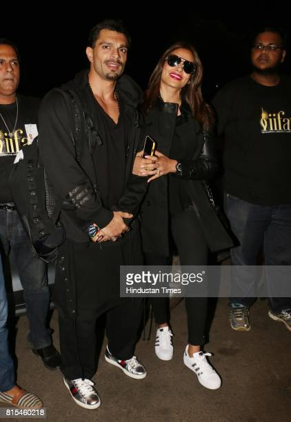 Bollywood actor Bipasha Basu with her husband Karan Singh Grover spotted at airport while leaving for IIFA on July 12 2017 in Mumbai India