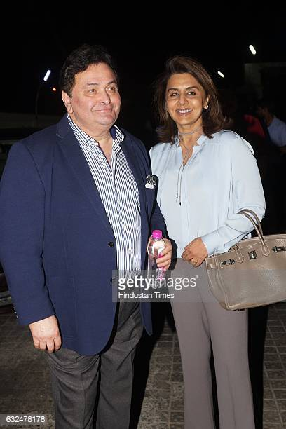 Bollywood actor couple Rishi Kapoor and Neetu Singh during premier show of action thriller Kaabil at PVR cinemas on January 21 2017 in Mumbai India...