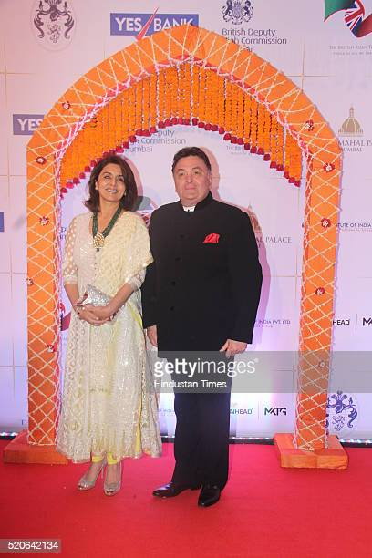 Bollywood actor couple Rishi Kapoor and Neetu Singh pose for the cameras as they arrive for the Bollywood theme dinner at the Taj Palace Hotel on...