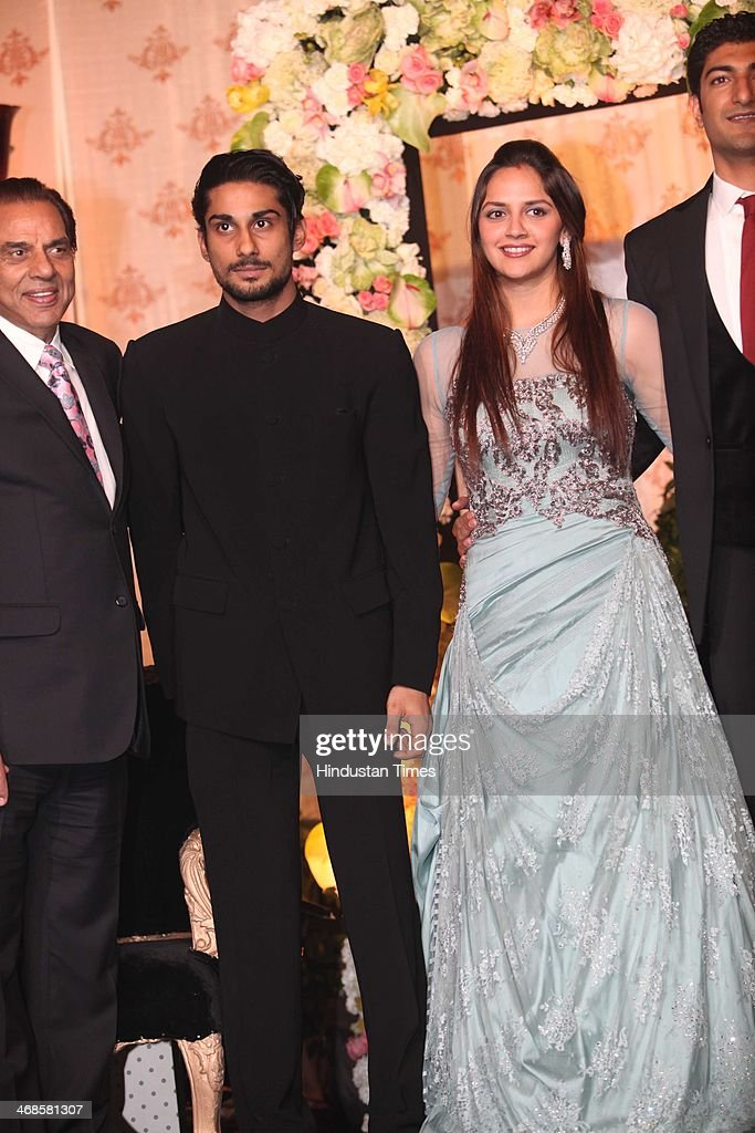 Bollywood actor Dharmendra (L) with actor Prateik Babbar (C) and Ahana Deol during the wedding reception of her and Vaibhav Vohra on February 5, 2014 in New Delhi, India. Ahana, a budding Odissi dancer, is the daughter of Bollywood stars Dharmendra and Hema Malini while Vaibhav in an Indian businessman. They married on February 2, 2014 in Mumbai.