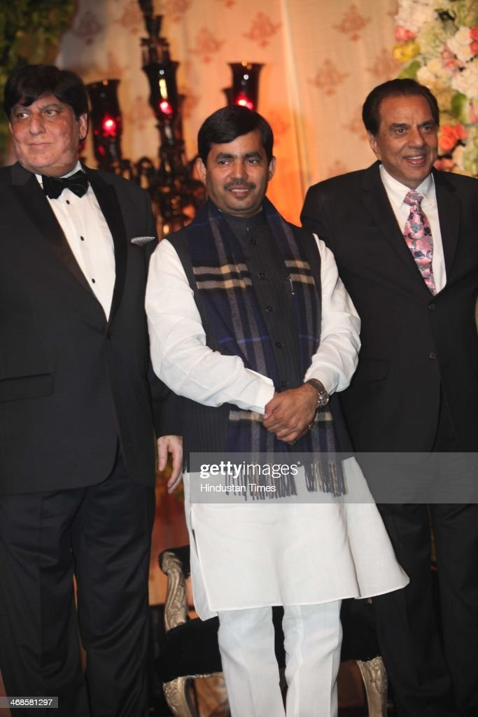 Bollywood actor Dharmendra (R) with BJP leader Shahnawaz Hussain (C) during the wedding reception of his daughter Ahana Deol and Vaibhav Vohra on February 5, 2014 in New Delhi, India. Ahana, a budding Odissi dancer, is the daughter of Bollywood stars Dharmendra and Hema Malini while Vaibhav in an Indian businessman. They married on February 2, 2014 in Mumbai.