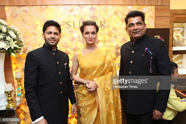 Bollywood actor Dia Mirza and Praveen Goel CMD Sunar and Pawan Chawala during the launch of Sunar Jewelry on April 20 2015 in New Delhi India